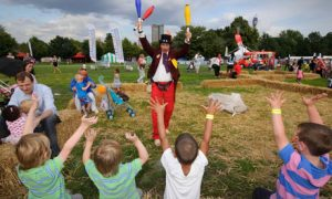A juggler entertains the kids at LolliBop festival